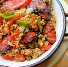 Piperade is a Basque scrambled egg dish with grilled veggies and meat added.