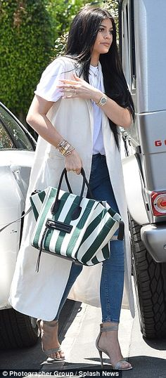 Pop of color: Kylie added a bit of color to her otherwise muted look by accessorizing with...