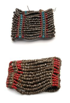 Africa | Bracelets from Lesotho | 20th century | Metal, glass beads and leather.