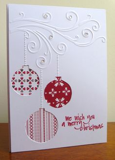 Christmas card...red & white...circles cut out of main layer and three different patterned papers placed underneath...lovely!!