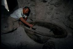 The Thera Foundation: Mr. Karamitros (head-worker) gently uncovers what archaeologists believe to be an ancient bathtub.