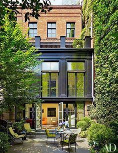 A townhouse featuring a double-height sitting area that leads to the garden | archdigest.com