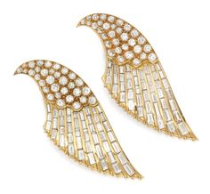A Pair of Diamond and Gold Clip Brooches, Designed as Stylized Wings, by Sterle, circa 1945. Available at FD Gallery.