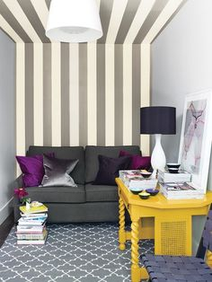 Photo Gallery: Double-Duty Offices Boldly Striped Den | houseandhome.com | stripes help move the eye across the ceiling, making tiny den appear larger