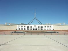 Parliament House, located in Canberra, Australia, was completed in 1988 and, at a cost of AU$1.1 billion, was the most expensive building in the world at the time it was constructed.  It houses Australia's government, with a chamber for the House of Representatives and one for the Senate.