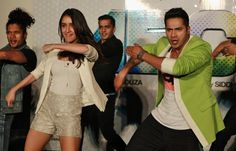 Bollywood actors Varun Dhawan, right, and Shraddha Kapoor perform during the trailer unveiling of ABCD 2 (Any Body Can Dance 2) in Mumbai, India, Wednesday, April 22, 2015. The movie is scheduled for release on June 19, 2015. (Photo by Rafiq Maqbool/AP Photo)