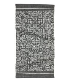 Check this out! Rug in woven cotton fabric with a printed pattern at front. - Visit hm.com to see more.