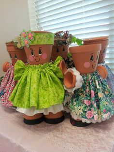 Flower pot girls made from flower pots painted with outdoor paint and dressed by hand