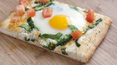 Quick & Easy Breakfast Pizza...Here's what you'll need: A tube of Pillsbury® Simply...® French Bread, a touch of butter and garlic powder, ricotta cheese, fresh spinach, shredded cheese, eggs and fresh diced tomatoes.