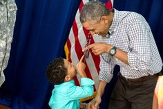 President Barack Obama and a young boy point at each other as the President greets Marine personnel and their families at Marine Corps Base Hawaii on Christmas Day, Dec. 25, 2014. (Official White House Photo by Pete Souza)