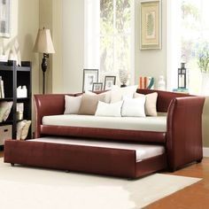 @Overstock - Bring some functional style into your home with this red daybed with trundle. Use this elegant piece of furniture as a sofa by day and a comfortable bed by night. It features a solid hardwood frame and a wine-red finish for extra style.http://www.overstock.com/Home-Garden/ETHAN-HOME-Deco-Wine-Red-Vinyl-Daybed-with-Trundle/6265717/product.html?CID=214117 $430.19