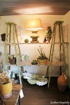 2 ladders, planks to create shelves; use for garden room to house flowers over the winter