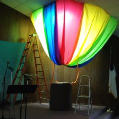 Sky vbs hot air balloon we made out of plastic table cloth! Any questions how… Vbs Themes, School Themes, Classroom Themes, Classroom Displays, Air Balloon Rides, Hot Air Balloon, Halloween Camping Decorations, Holiday Decorations, Trendy Halloween