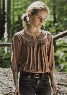Emma Watson as Hermione Granger in Harry Potter and the Deathly Hallows (Part 1), wearing a really cute outfit.