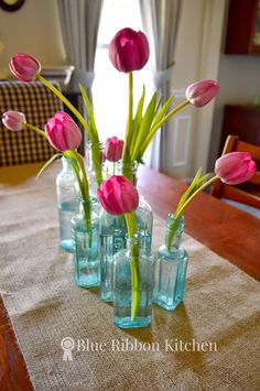 Blue Ribbon Kitchen   Easy Table Centerpiece Using Vintage Medicine Bottles and Tulips.  Springtime Table Flowers