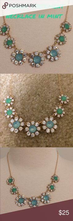 NWT flower statement necklace in mint Spring is just around the corner..let the flowers bloom with this statement necklace in the shape of flowers that are blue and mint green in the center with crystal like stones as the petals..comes with matching earring studs that have posts. Comes with a gold chain.  Never worn.  Adjustable length to about 16-18 in with lobster claw clasp..Boutique brand. Jewelry Necklaces