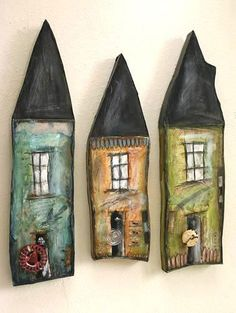 Mixed media houses. Wonder if you could do these with either saltdough or maybe Fimo or something similar, hotly followed by acrylic paint...