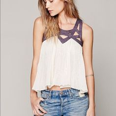 Free people latticed lurex top LLAST CHANCE! all items will be donated in the morning if not purchased tonight. LIKE NEW. White and purple top with gold detailing. This is one of my favorite tops! I'm debating selling it because it isn't super flattering on my petite figure. It has been worn maybe 3 times and is in perfect condition. Make me offers! Will go lower on m. Free People Tops Blouses
