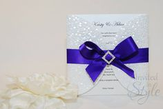 Handmade wedding invitation - Ivory Pebble Petal invitation tied together with striking purple ribbon, embellished with an A-grade diamante slider.