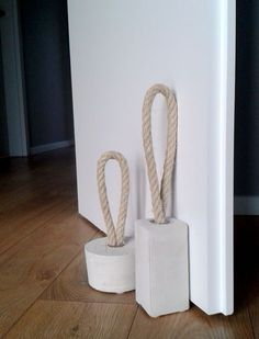 Concrete door stoppers with rope. I love them! And they're useful and can be used as some type of decor (nautical, perhaps?)