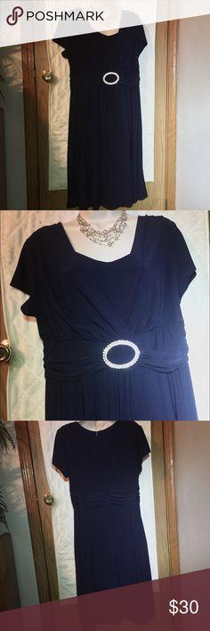 Navy blue v neck dress w/ rhinestone center piece Navy blue v neck cap sleeve fancy dress with rhinestone center piece. Mid length. NWOT. Size 16 Dresses