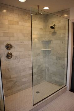 Walk-in shower with knobs away from the shower head.
