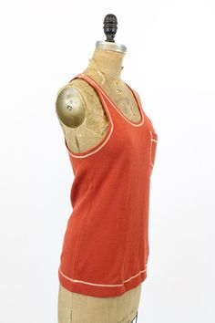 Amazing late 60s Alvin Duskin tank top. Done in a lightweight wool blend knit. Brick red color. One chest pocket. Duskin, is credited with being the