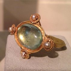 "Absolutely stunning Byzantine glass and pearl gold ring. The subtle coloring of the aquamarine glass, pearl and gold on this early 6th c. ring is breathtaking! On view @lesenluminures NY gallery until Dec 3rd, as part of their current exhibit titled ""Rings Around The World"" - which ""...explores the eternal forms, inspirations, and aesthetics of finger rings across many cultures throughout history..."". Was fortunate to just see this ring along with app. 40 other rings at a private tour and…"
