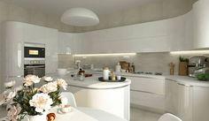 o bucatarie in care albul lucios amplifica vizual spatiul si creeaza un ambient fluid. liniile arcuite ale mobilierului creeaza un efect unic. Home Kitchens, Unic, Kitchen Island, Table, House, Furniture, Home Decor, Kitchen Dining, Kitchen Design