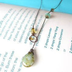 Turquoise, green, blue and amber Czech glass are organically hand wrapped and linked on oxidized sterling silver and bright copper.