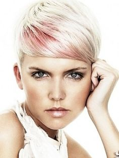 Beautiful side swept pixie cut with pink highlights