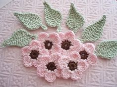 Thinking of using some crocheted flowers to embellish some onesies.