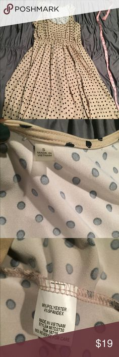Beautiful! Nude/Black Polka Dot Fit n' Flare Dress Beautiful high quality fit n flare style polka dot dress. Nude with black dots. Size small, definitely big enough to fit a medium. Polyester and spandex. Not sure of the brand but it was purchased at Macy's and worn a couple of times. Excellent condition! Dresses Midi