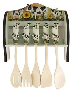 """Moo-tensil Hangar  Cow moo-ti-ful !  This is a very detailed kitchen wall hangar. The handles on the utelsils are porcelain, and each handle has three cows ! The hangar iteslf is also quite moo-ti-ful. The utensils are nice 'long' wooden utensils.. but yuo probably will never moos them for sphagetti they are too pretty !    We think that you and your guests will like this piece... we do !    ND970 12"""" long x 14"""" high Price 29.95    http://www.cowdepot.com/cowkitchen.html"""