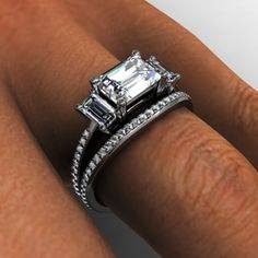 White gold three stone emerald cut diamonds diamond accent engagement ring with matching side diamond wedding band