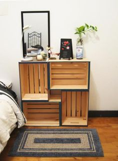 My lovely DIY shelf in my guest room using 4 crates stacked together! Simple edge-paint project that ties the colors of the room together immediately. All my guests compliment it all the time. It is very sturdy and holds heavy books to sweaters.