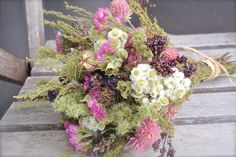 Dried flower bouquet in pinks and greens. All natural.