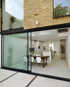 Roundhouse Urbo bespoke kitchen in room leading directly in to garden