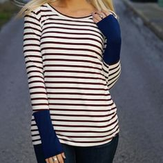 Burgundy striped contrast button back top Brand new without tags. Bought and never worn.  Burgundy and Ivory striped long sleeve top with navy cuffs and button down back.   96% Modal, 4% Spandex Tops Tees - Long Sleeve