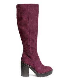 Knee-high boots with a half zip at side. Chunky rubber soles. Front platform height 1 1/4 in., heel height 4 1/4 in.