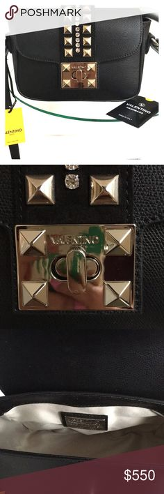 NWT Valentino leather crossbody bag NWT. 100% authentic. Silver hardware. Just a gorgeous complement to any/every outfit, dressed up or down. Dust bag included. It's gorgeous! Valentino Bags
