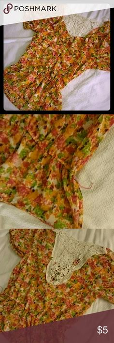 Crochet back ruffled blouse Crochet back blouse with button up front and ruffles. Has belt loops, but one is broken as pictured (not noticeable when worn). Tops Blouses