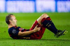 Andres Iniesta of FC Barcelona lays injured during the UEFA Champions League Group E match between FC Barcelona and Bayern 04 Leverkusen at Camp Nou on September 29, 2015 in Barcelona, Catalonia.