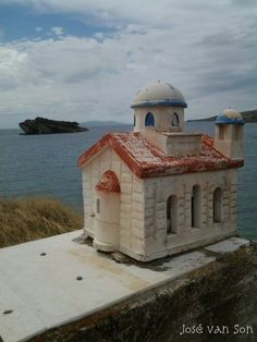 Patina Ikonostas Kandylakia roadside Shrines to Lives Lost and Saved overlooking Hydra island Greece