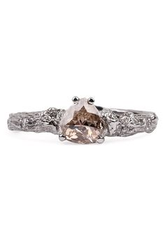 K. Brunini's 18k white gold size 5.5 twig ring set with a center .47ct rose cut diamond and .08ctw sparkling accent diamonds. Available at Oster Jewelers.