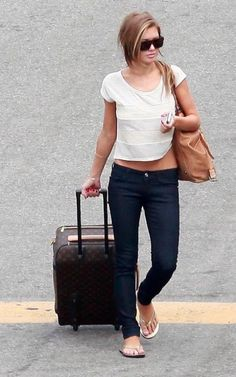 Audrina Patridge in a white t-shirt, skinny jeans, flip-flops, and sunglasses.