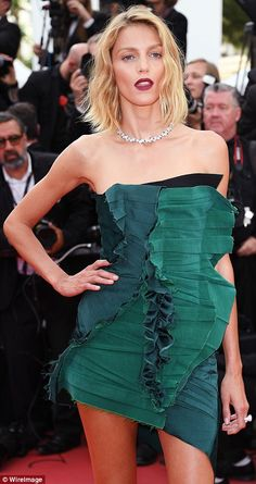 Green with envy:Her strapless number featured frayed ruching and ruffles down the middle ...