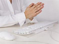 Praying Hands Over a Computer a Keyboard