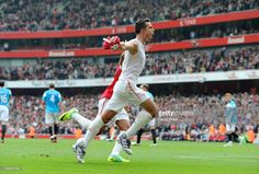 Robin van Persie of Arsenal celebrates scoring Arsenal's second goal during the Barclays Premier League match between Arsenal and Sunderland at Emirates Stadium on October 16, 2011 in London, England.