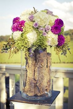 So many current trends - logs, dahlias, hydrangeas, green, purple - love it!